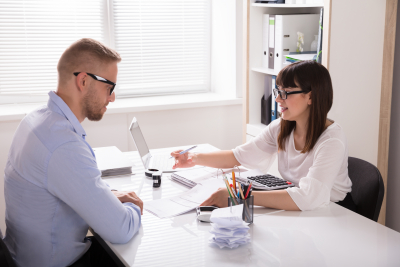 young financial advisor discussing with her client